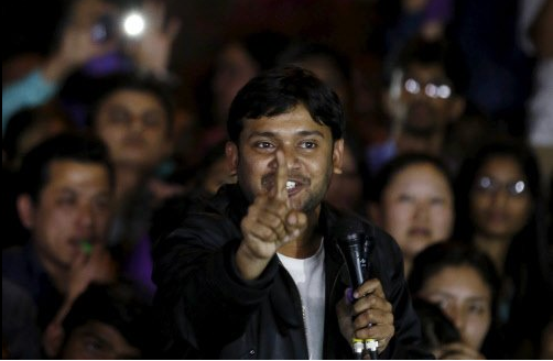 A man sitting in the audience threw a shoe at Kumar but it missed the target and fell just ahead of the stage.