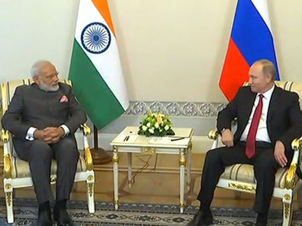 Prime Minister, Narendra Modi, Russian President, Vladimir Putin, Russia, bilateral ties, NewsMobile, World, Mobile News, India