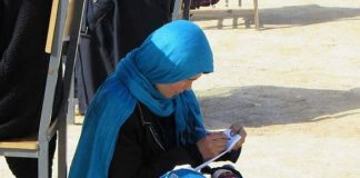 Afghan woman, university exam, caring, baby, picture, viral, NewsMobile, Afghanistan, Mobile News, India
