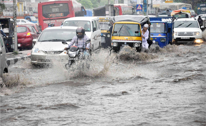 Heavy rain showers in Delhi lead to water logging and traffic jams