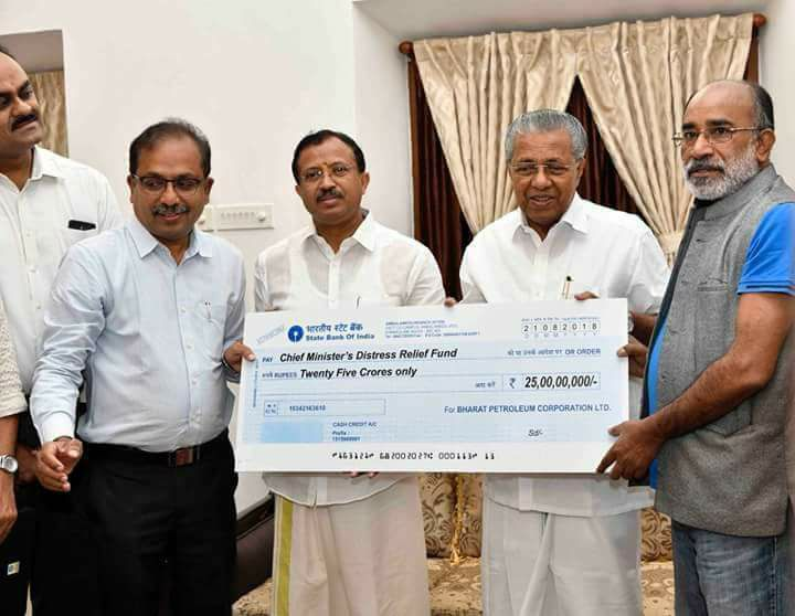 Kerala, Floods, BJP, minister, donate, Rs 25 crore, cheque, NewsMobile, Mobile News, India, Fact Checker, Fact Check, Fake News