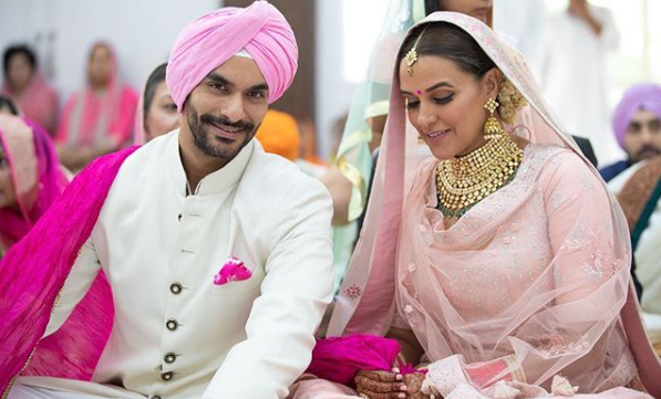 Neha Dhupia, Angad Bedi, first child, Bollywood, NewsMobile, Entertainment, Mobile News, India