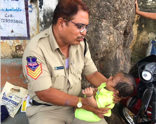 Picture, Telangana, cop, consoling, crying baby, Viral, NewsMobile, Mobile News, India
