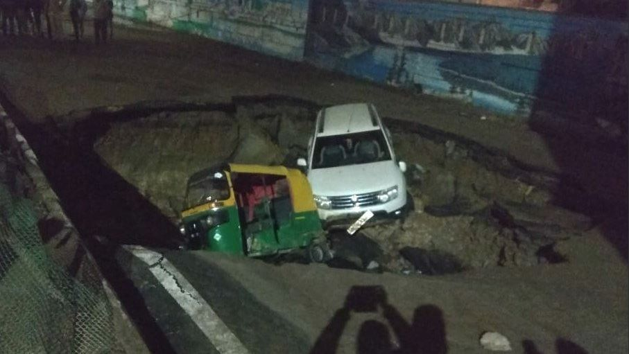 Delhi road collapses, vehicles go down