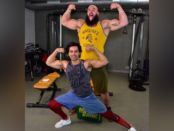 Varun Dhawan, Braun Strowman, WWE, muscle flex, WWE,Sui Dhaaga