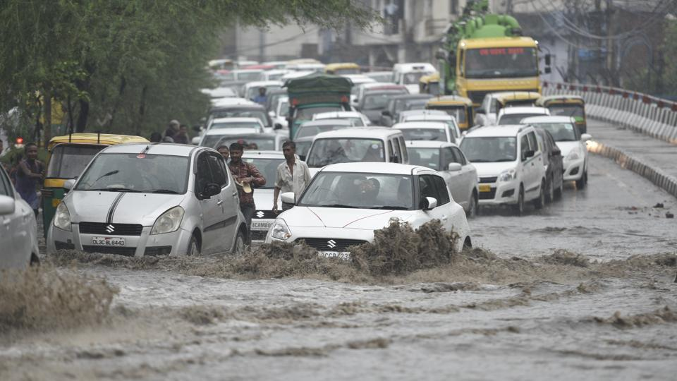 Delhi remains water logged as rain showers continue