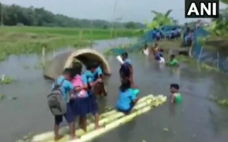 These kids in Assam swim to school daily