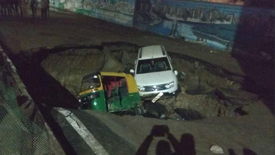 Delhi road collapses, vehicles go down